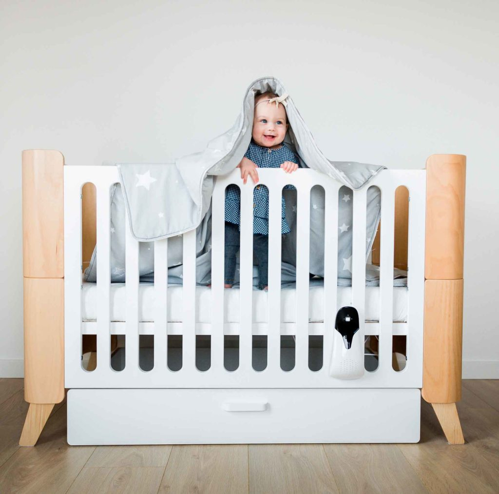 Babybett Hoppa mit Kind